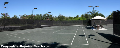 The Har-Tru tennis courts at Canyon Isles are lighted for evening play.