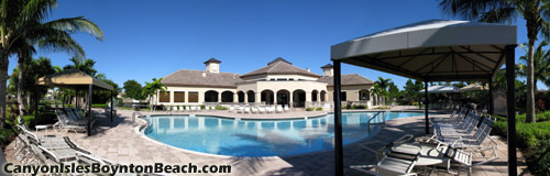 Relax in the Florida sun, or in the shade beside the main pool at Canyon Isles.